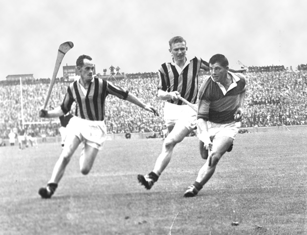 Ted Carroll and Pat Henderson close in on Babs Keating in the 1964 All Ireland Final.