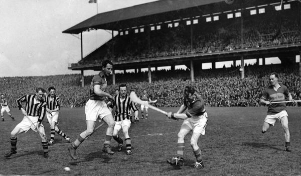1950 League Final Action<br /> From left: PJ Garvan, Mick Kenny, Tony Brennan (T), Jimmy Heffernan, Pat Shanahan (T), Mick Byrne (T), Seamus Bannon (T).