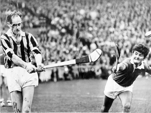A bloodied Ted Carroll and Charlie McCarthy in the 1969 All Ireland SH Final.