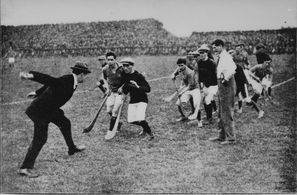 Michael Collins, himself a fine hurler, throws in the ball at the start of the 1921 Leinster Hurling Final.<br /> From left: Michael Collins, Joe Coyne (originally Dicksboro - lived/hurled Dublin), Paddy Donoghue, Mattie Power,  Ref John Dunphy.