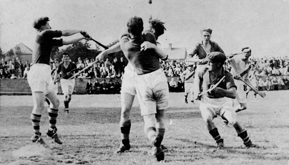 Action from the 1947 County Final between Eire Og and Tullaroan.<br /> Eire Og Goalie, Ramie Dowling, keeps his eye on the ball as defenders, Nick O'Donnell, Ches Phelan, Diamond Hayden (cap) and Michael Neary close in. The Hennessy brothers and John Walton are the Tullaroan Players.