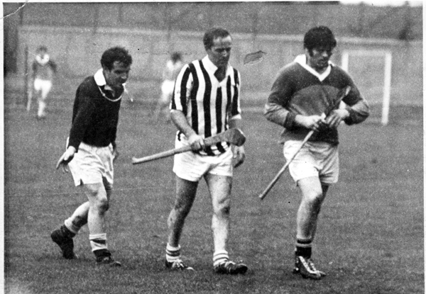 Eddie Leahy (Foulkstown) and Billy Dan Nolan (Newpark Sarsfields) get their marching orders from Referee Fan Larkin in a Junior Championship game in the sixties.