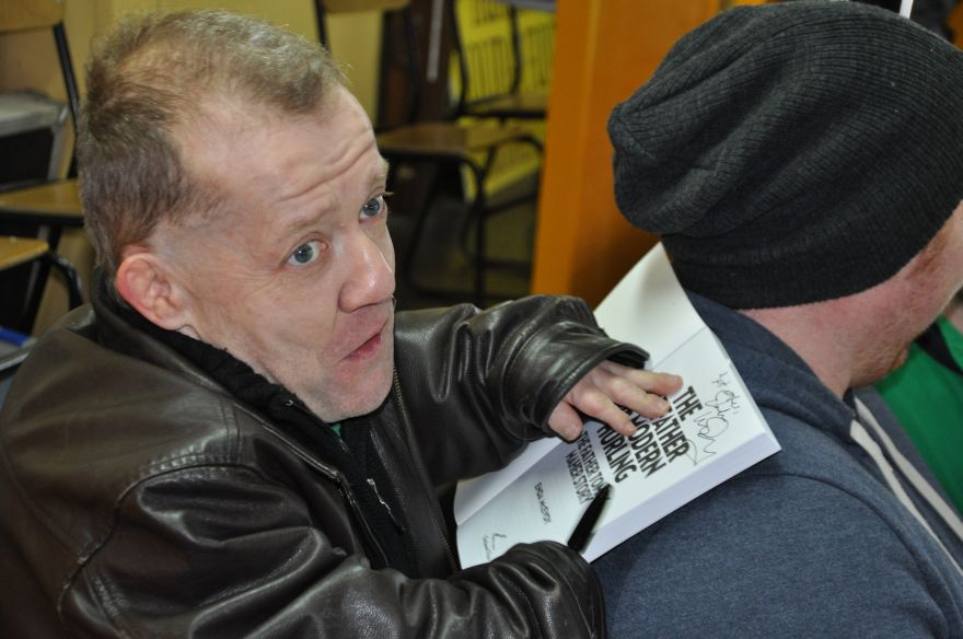 """Enda McEvoy the Author of """"The Godfather of Modern Hurling"""" """"The Fr. Tommy Maher Story"""" signing copies at the County Senior Semi Finals"""