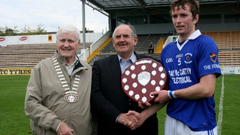 Fenians Captain John Henderson accepting Shield from Co Board Chairman Ned Quinn and President St Canices Credit Union Michael O Reilly