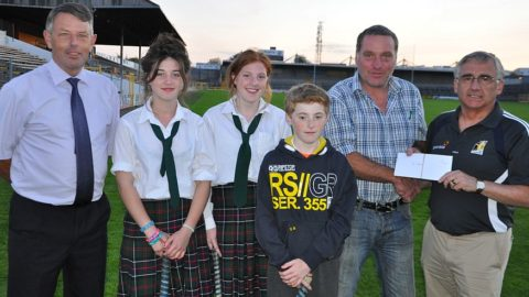 Photo: Seamus Reade Comm. Chairman, the Walsh Family, Ger Walsh recieves second prize for the Walsh team that participated in the Salmon Pool from Barry Hickey County Treasurer.