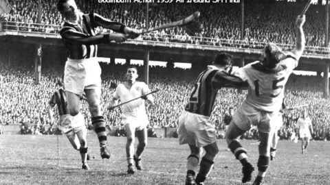 Ollie Walsh makes a save in the 1959 All Ireland Final while under pressure from Larry Guinan while Tom Walsh takes care of John Kiely.