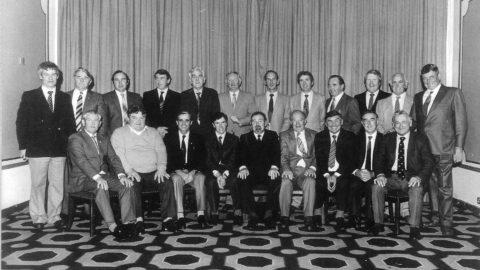 "Kilkenny 1957 Team Honoured by Irish Nationwide 1982 Back: Ned Fenlon, Willie Murphy, Liam Cleere, Dick Rockett, John Sutton, PJ Garvan, Mick Brophy, Sean Clohessy, Mick Keny, Ollie Walsh, Bill Walsh, Jim ""Link"" Walsh. Front: Johnny McGovern, Billy Dwyer, Paddy Buggy, Denis Heaslip, Michael Fingleton (INBS), Mickey Kelly (Capt), Mickey Walsh, Tom Walsh, John Maher."