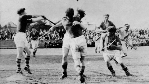 Action from the 1947 County Final between Eire Og and Tullaroan. Eire Og Goalie, Ramie Dowling, keeps his eye on the ball as defenders, Nick O'Donnell, Ches Phelan, Diamond Hayden (cap) and Michael Neary close in. The Hennessy brothers and John Walton are the Tullaroan Players.